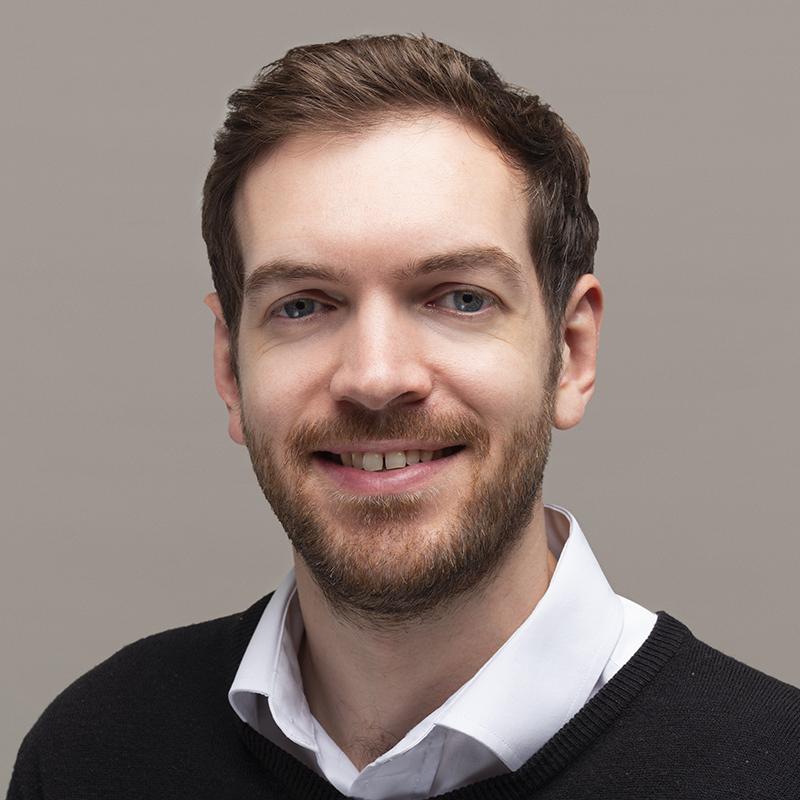 Headshot of Greg Bortkiewicz, account manager at Magenta Associates