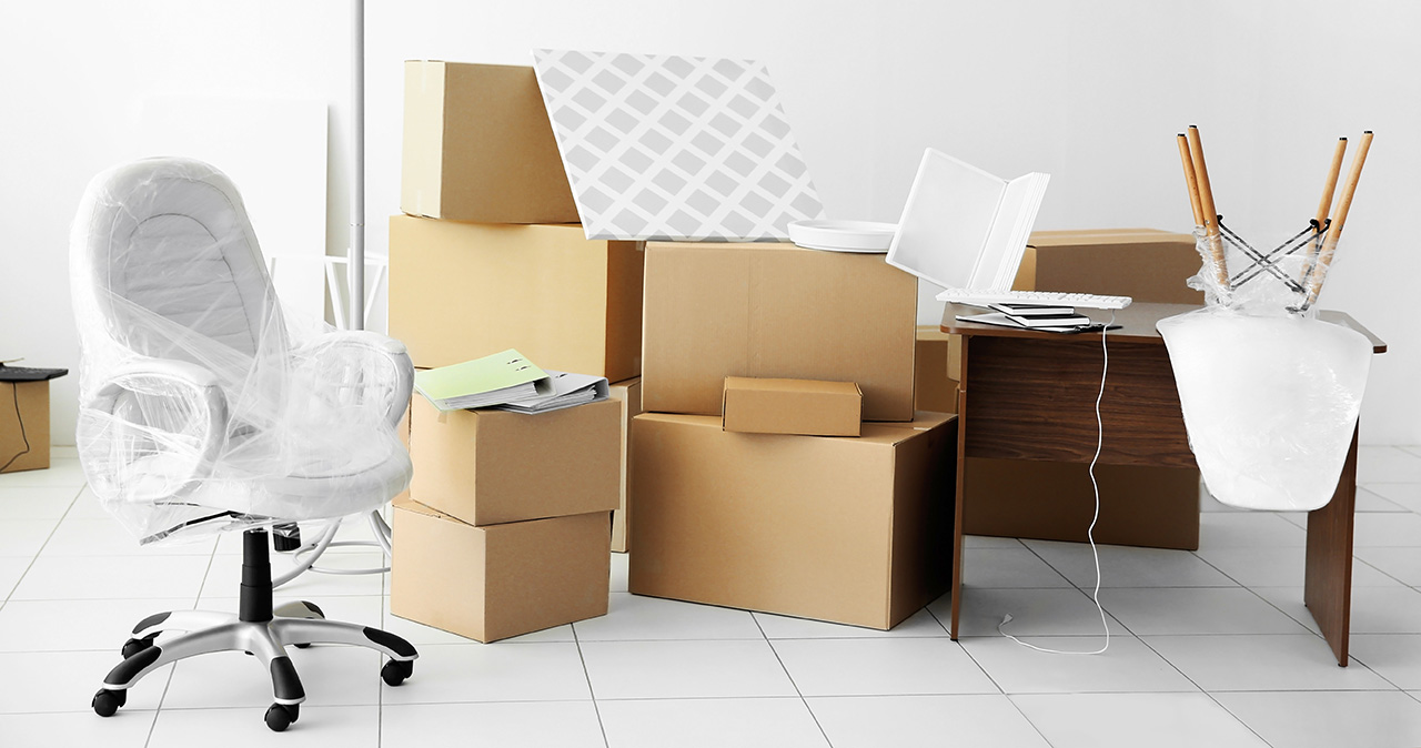 Cardboard boxes and office furniture are part of what is discussed in office move communication.