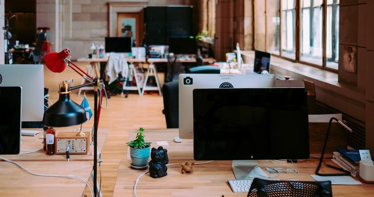 Desks with personal belongings in an empty office