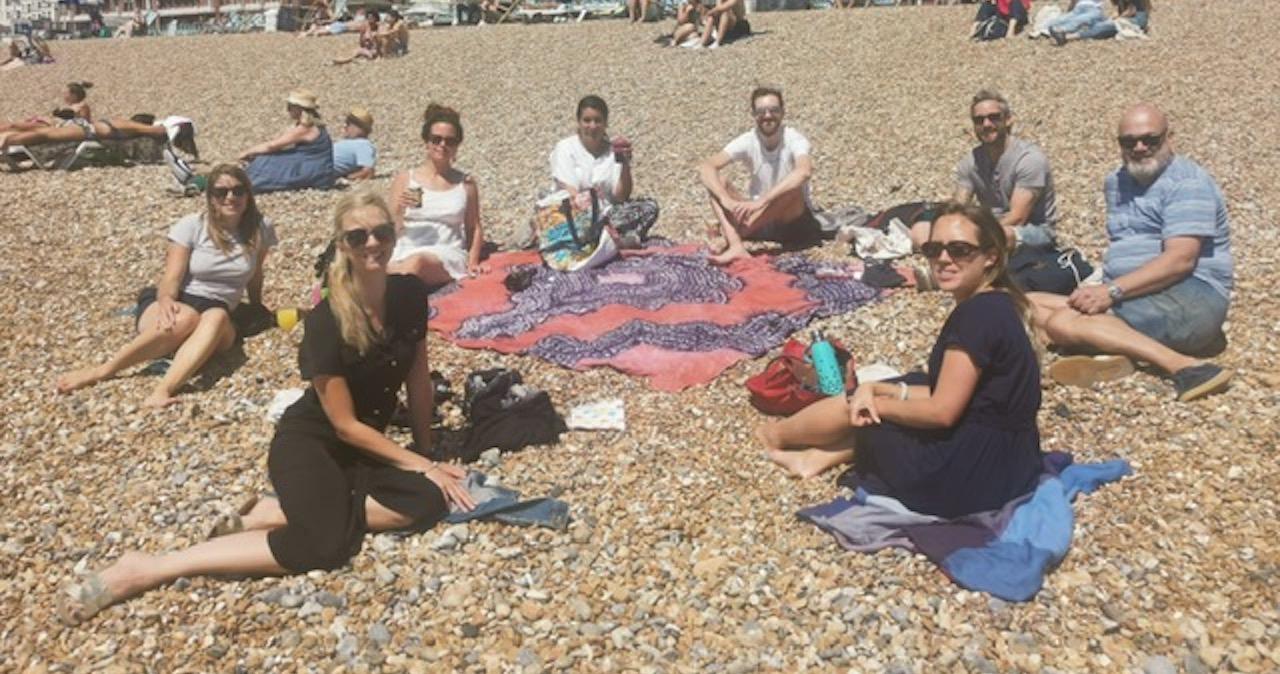 The Magenta team having lunch on Brighton beach in summer 2020
