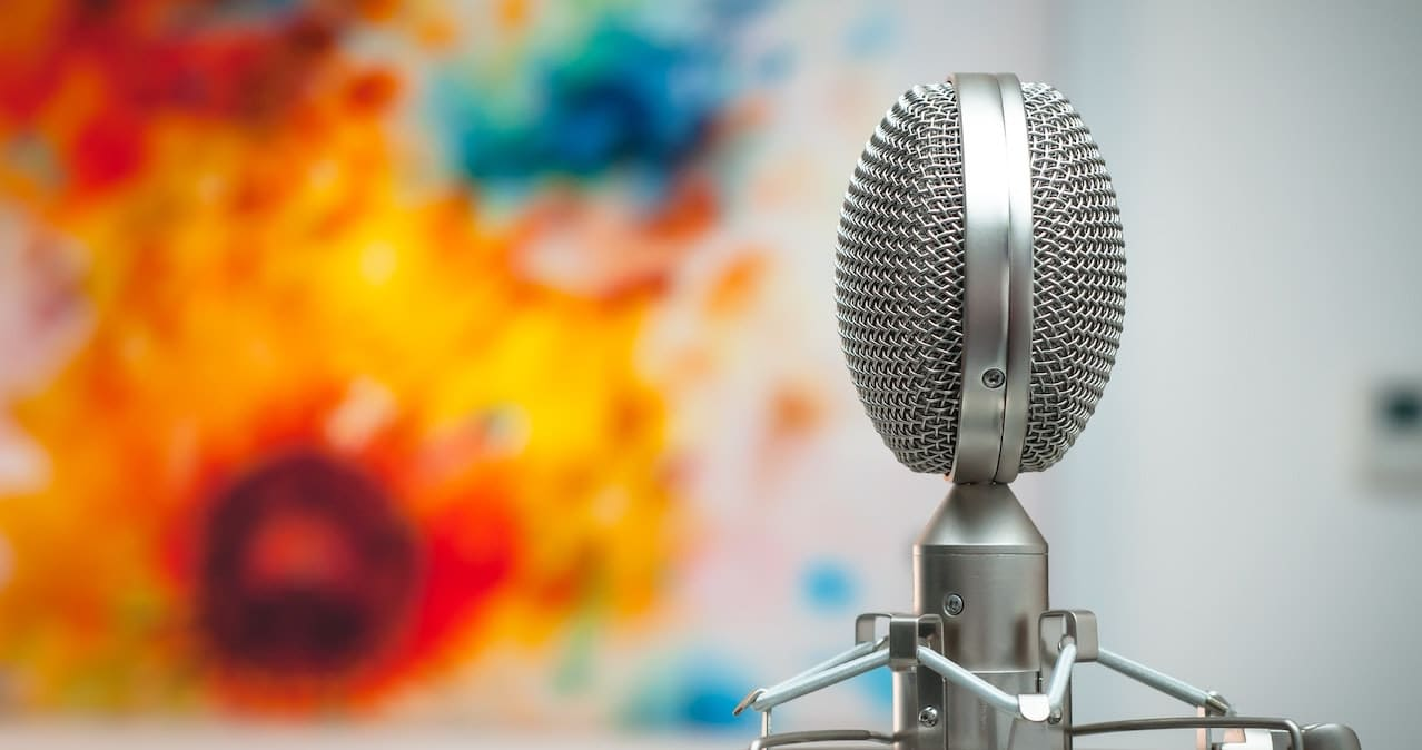 A grey microphone in an empty room