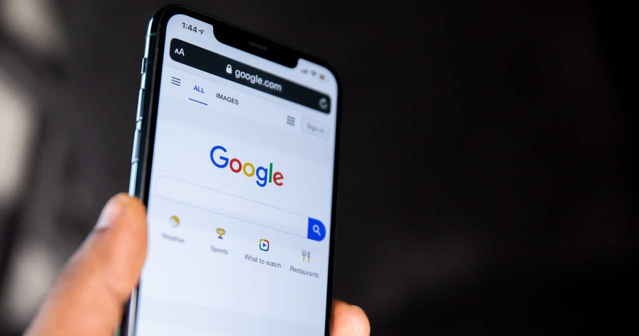 A person uses Google search on a mobile phone
